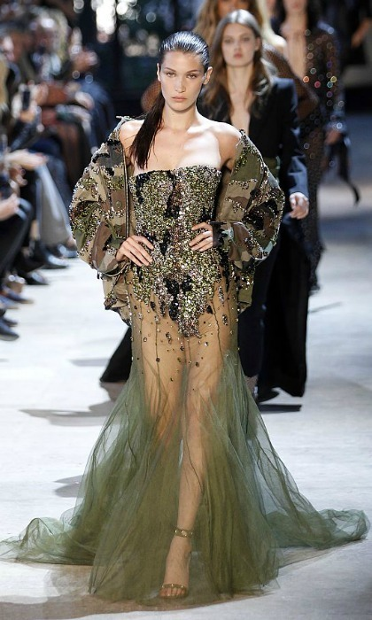 Bella Hadid owned the Alexandre Vauthier runway in an embellished army-inspired gown with a sheer skirt that showcased her trim legs.