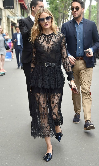 Olivia Palermo turned the streets of Paris into her own personal runway as she stepped out in a daring, black lace number for Elie Saab.