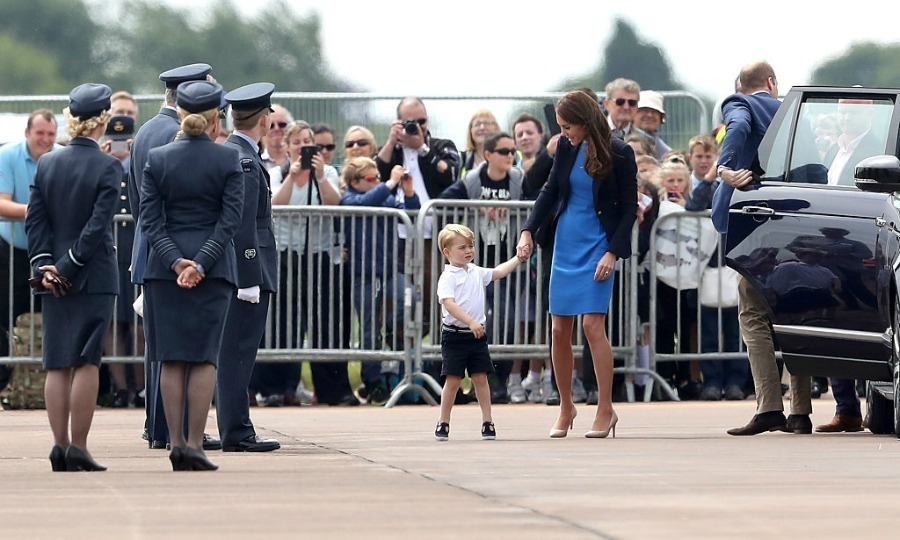 The little prince arrived for his big day with his mom and dad in the family's Range Rover.