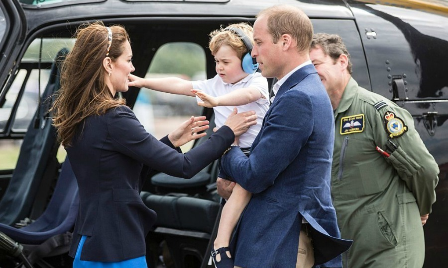 Come to mommy! George reached out for Kate while touring the aircrafts.