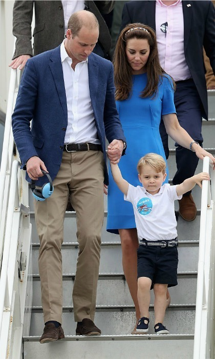 George received a little assistance from his dad as they made their way down the stairs.