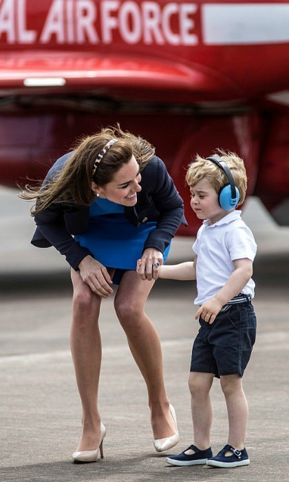 Kate exuded happiness walking hand-in-hand with her son around the the Air Show.