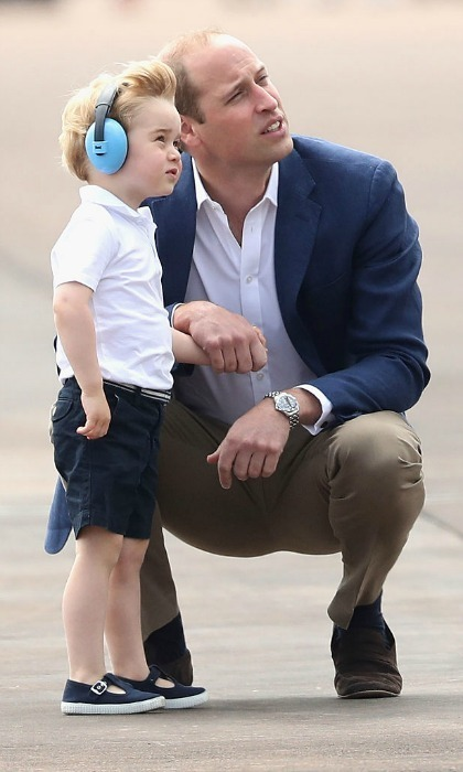 Like father, like son. The Cambridge men took in their force base surroundings together.