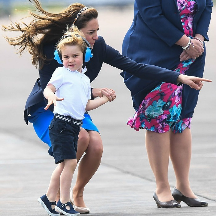 The little royal struck a pose as his mom pointed out something in the distance.