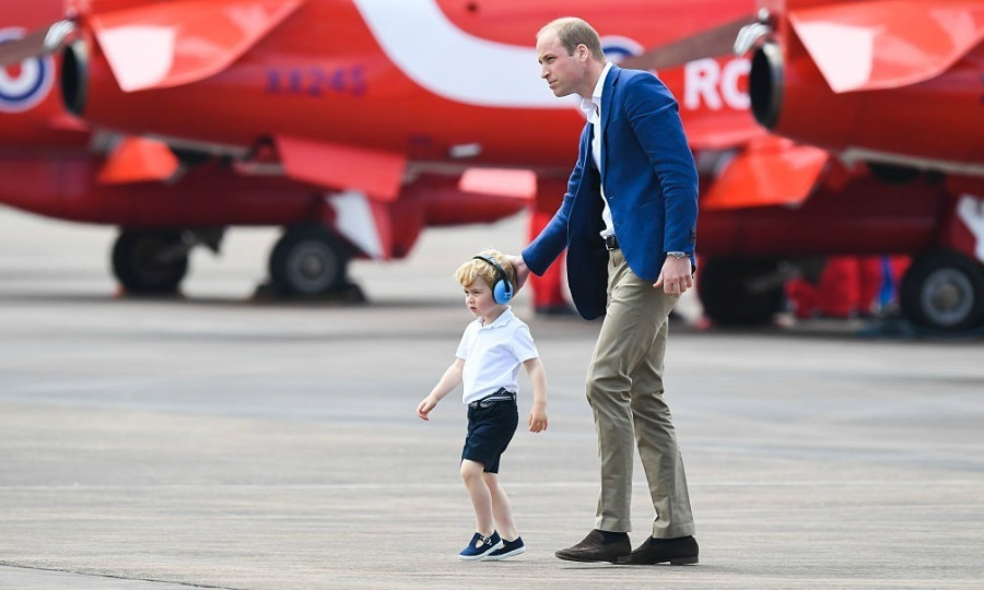 George certainly looked comfortable as he made his way around the base inspecting helicopters and planes.