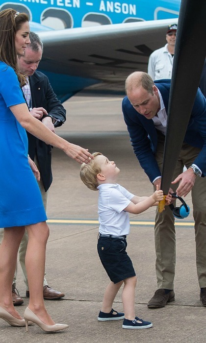 Not only did Prince George get to sit in a cockpit, but he also got to touch the propeller of a plane, with his mom standing close.