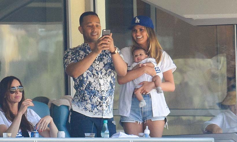Happy parents John Legend and Chrissy Teigen took their daughter Luna to her very first Dodgers game in Los Angeles. 