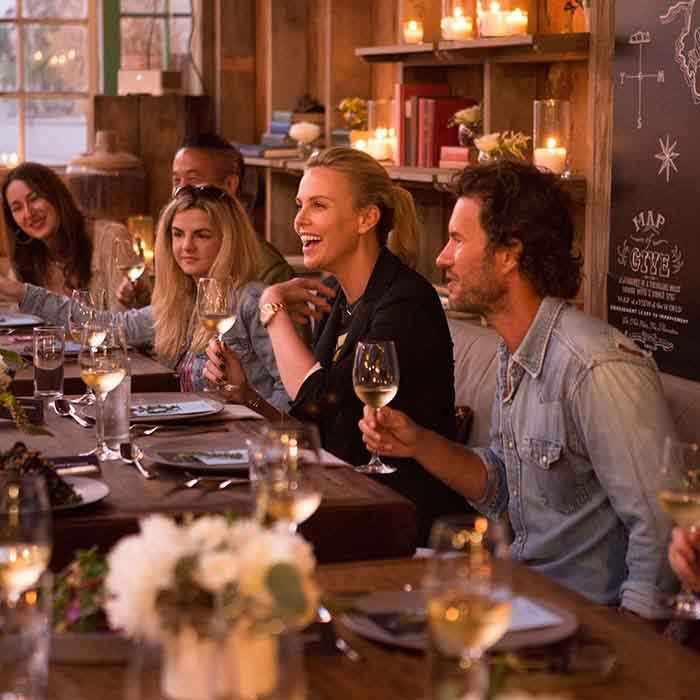 Charlize Theron and TOMS founder Blake Mycoskie celebrated the launch of the TOMS X Charlize Theron Africa Outreach Project during a dinner in Los Angeles. 