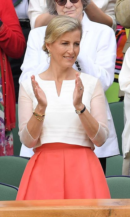 The Countess of Wessex made a fashionable Wimbledon appearance in a white loose-fitting top and coral midi skirt.