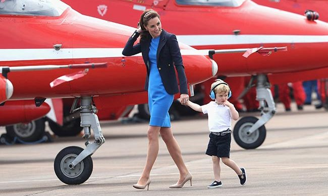 Kate took Prince George on his first UK engagement in a cobalt blue Stella McCartney dress and blazer by Canadian brand Smythe.