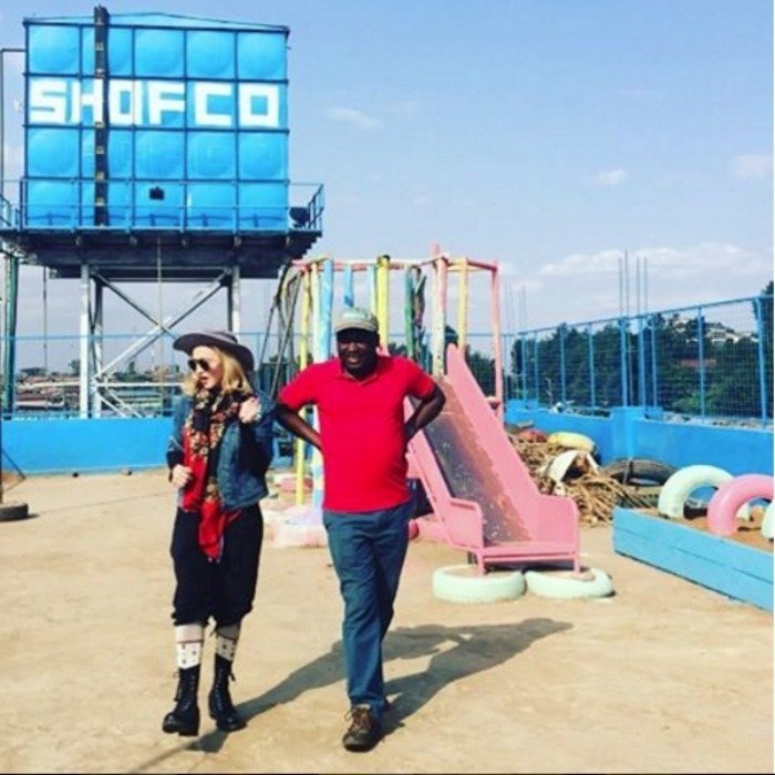 Madonna walked around a playground for students in Kibera with the founder of Shining Hope for Communities. The organisation provides goods and services to school girls in the country.