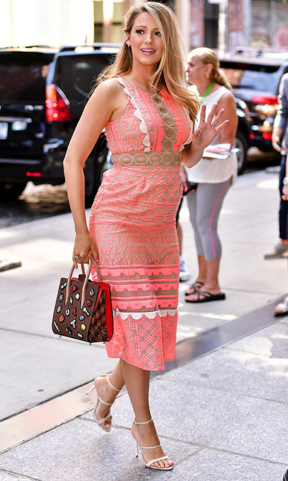 After enjoying the Fourth of July with husband Ryan Reynolds at Taylor Swift's Rhode Island home, it was back to fashionable business for the actress as she stepped out in New York wearing a patterned coral dress, strappy heels and a Louis Vuitton bag en route to do press for her new film <i>Cafe Society</i>. 