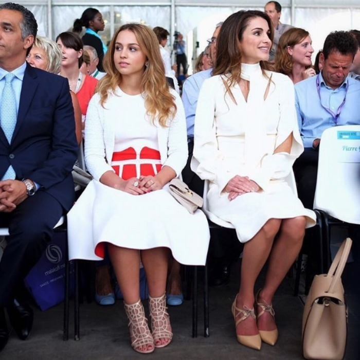 The teenager often takes a page from her mother's style book and mirrors her fashion choices. When the duo attended the grand opening of the Medef Summer Conference in Jouy-en-Josas, near Paris, they both went for white. Iman's structured skater dress with bold red detailing is by Alexander McQueen, one of Duchess Kate's favorite designers.