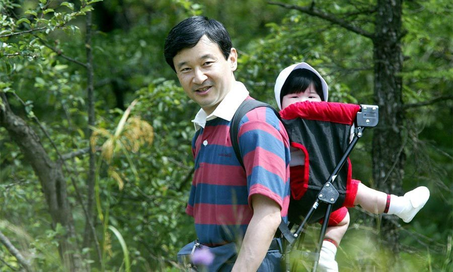 The father-daughter duo enjoyed some bonding time together during a walk in the woods on a family holiday in Tochigi Prefecture during the summer of 2002.