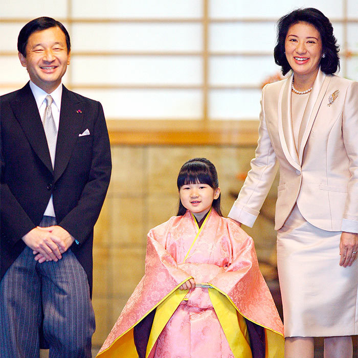 Completing a Japanese royal family rite of passage, Aiko dressed up in a traditional Kimono coat for the Chakkonogi ceremony. The Princess looked sweet in the pink and yellow outfit as she was accompanied into the ceremony by her proud parents.