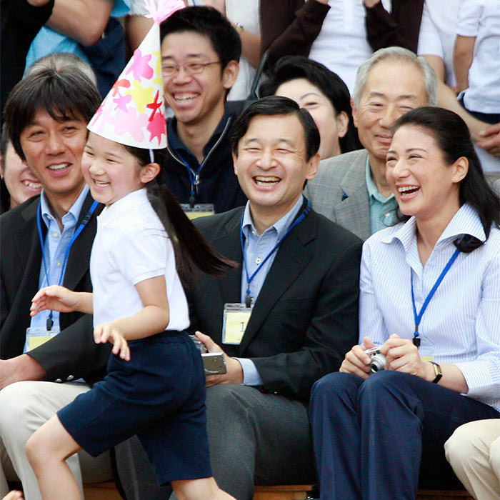 The emperor- and empress-to-be watched on gleefully as their only child danced around with fellow students at her school's athletic festival in 2007.