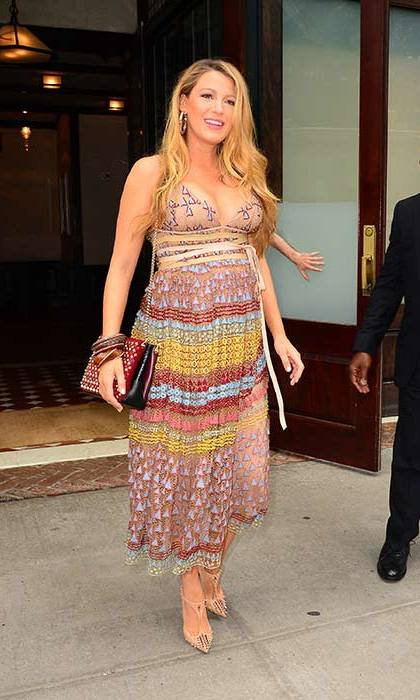 Working a cool bohemian look in a patterned midi dress and studded heels.