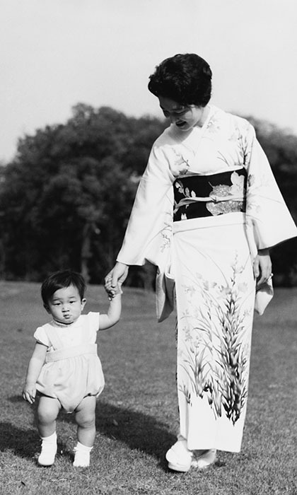 Crown Prince Naruhito with his mother Empress Michiko in the grounds of Togu Palace in Tokyo in 1961.