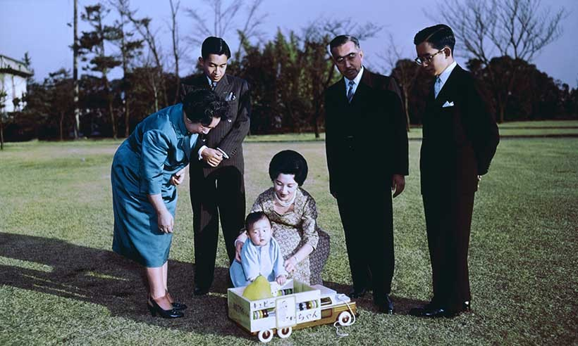 Left to right: Empress Nagako, Crown Prince Akihito, baby Prince Naruhito, Princess Michiko, Emperor Hirohito and Prince Hitachi in the gardens of the Imperial Palace circa 1961.