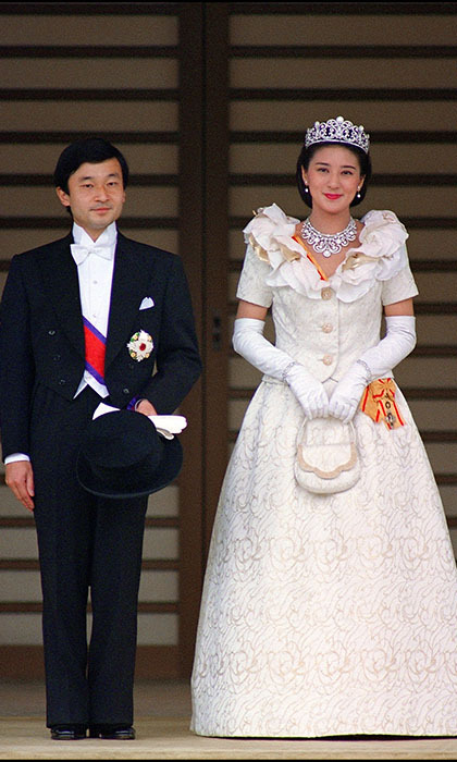 Newlyweds Crown Prince Naruhito and Crown Princess Masako pose for photographs following their wedding in 1993. 