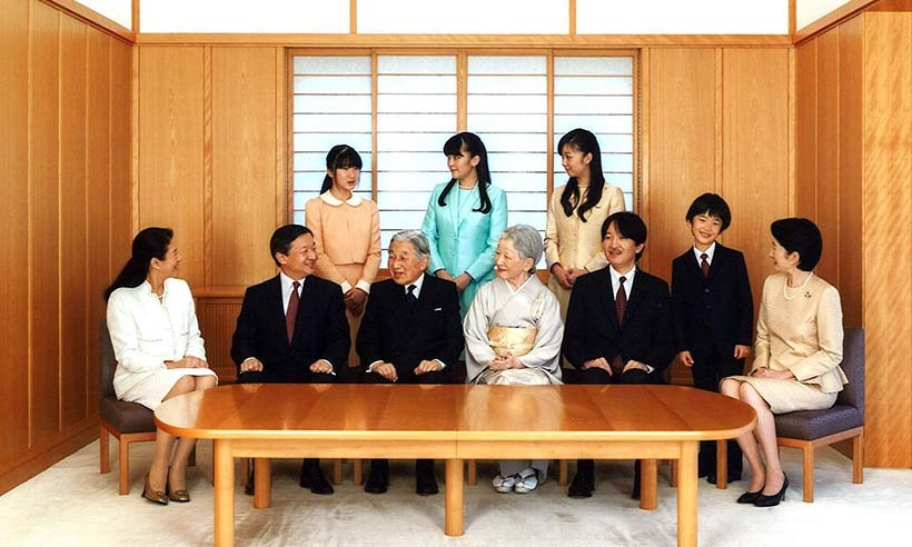 2015: Japanese Emperor Akihito, seated third left, and Empress Michiko, seated fourth left, smile with their family members during a photo session for the New Year at the Imperial Palace in Tokyo.