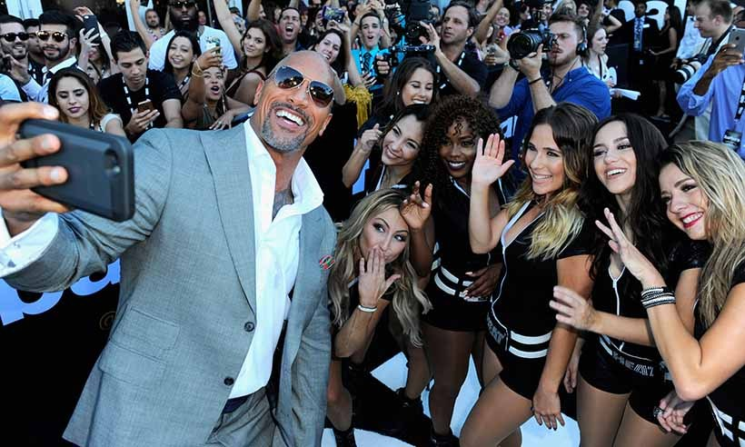 At the Miami premiere of the second season of <em>Ballers</em>, star Dwayne Johnson posed for a selfie with fans.
