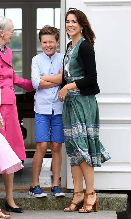 Princess Mary of Denmark worked easy summer style in a patterned midi dress and tan sandals.
