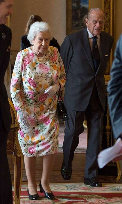 The Queen wore a pretty floral dress and white gloves as she attended a reception at Buckingham Palace on Thursday.