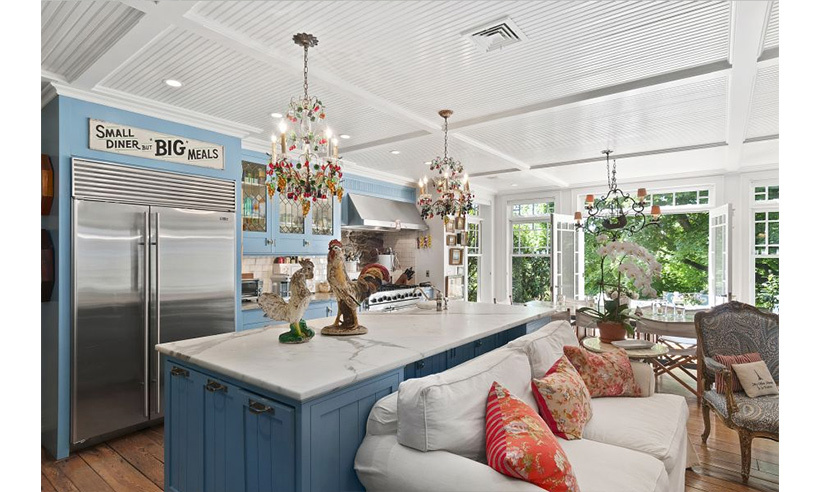 The over-sized country-themed kitchen. 