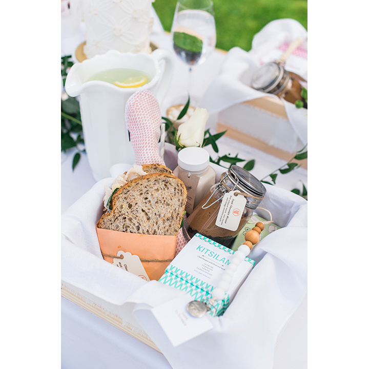 Lunch came in cedar boxes filled with sandwiches, cheesecake in a jar, macaroons, a candle, flowers and almond milk.
