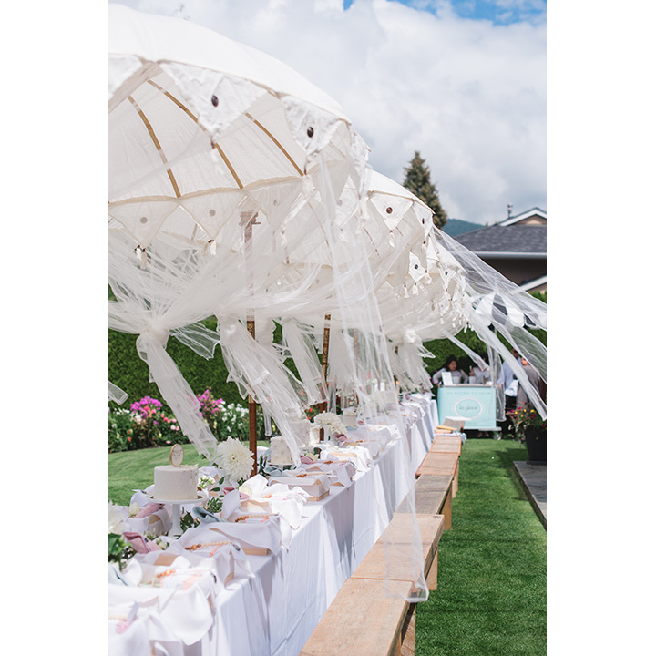 Lunch was served at a long table draped in tulle fabric and lined with flowing white parasols. 