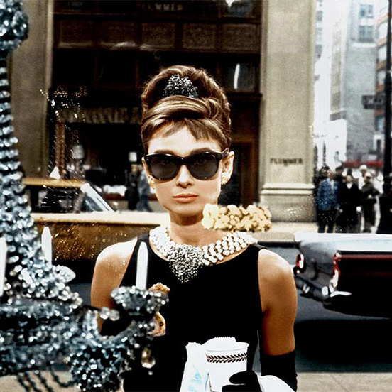 Audrey Hepburn's elegant updo in <em><strong>Breakfast at Tiffany's</strong></em> remains a firm classic, with stars still recreating the look on the red carpet to this day. 