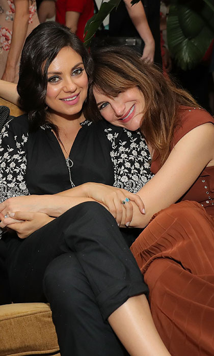 Mom-to-be Mila Kunis cuddled up with her co-star Kathryn Hahn at a party for their new comedy <i>Bad Moms</i> in New York.