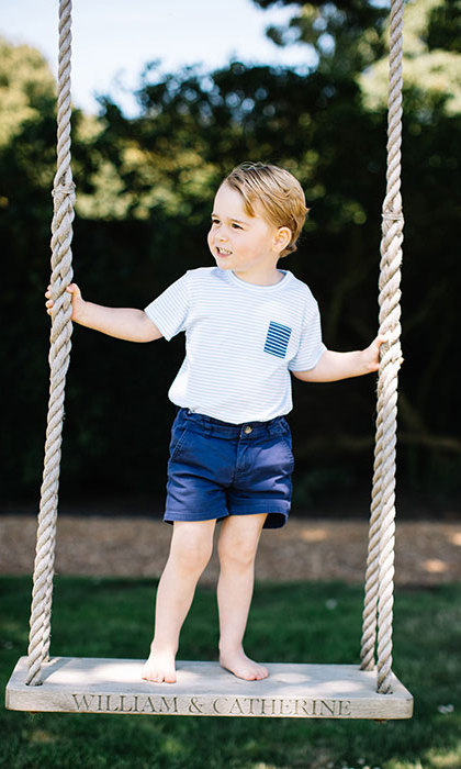 One particularly sweet snapshot showed the little Prince stood bare-foot on a large wooden swing, which has been etched with the names of his parents.