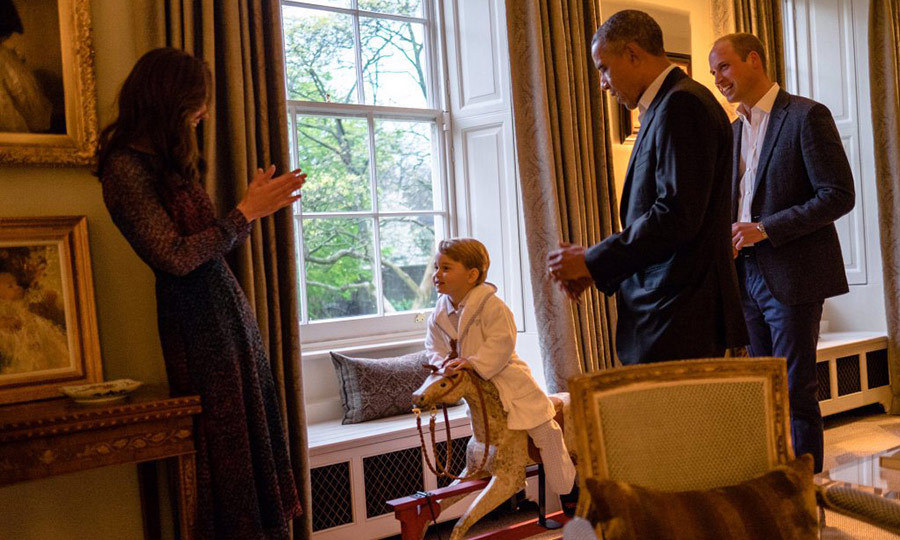 The two-year-old was allowed to stay up late to thank the couple for a rocking horse and stuffed toy dog they had previously given him as gifts, and played on the toy while his parents and visitors looked on.
