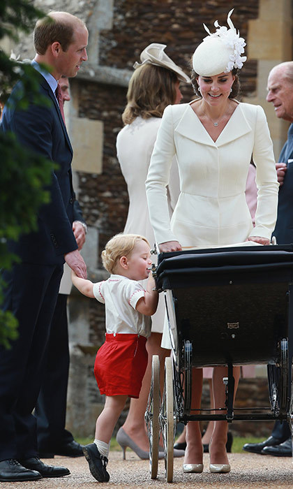 The Cambridges made their first outing as a family of four at Princess Charlotte's christening in July 2015, and Prince George couldn't resist taking a peek into his sister's pram as they mingled outside the church.