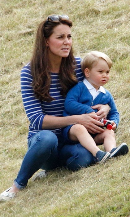 The Duchess kept a firm grip on George as he threatened to run amok at the polo game in Gloucestershire.