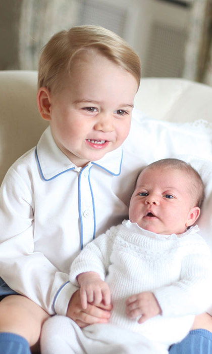 The images were taken by their proud mother Kate in June 2015, and showed that Prince George had quickly adjusted to life as a big brother.