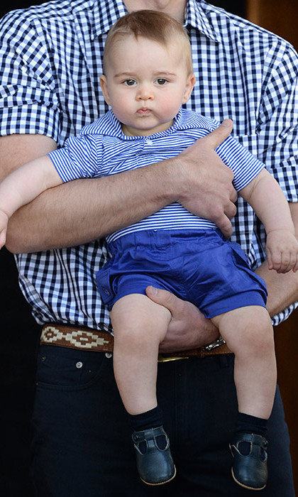 Prince William cradled his active baby son in his arms as they explored the zoo.