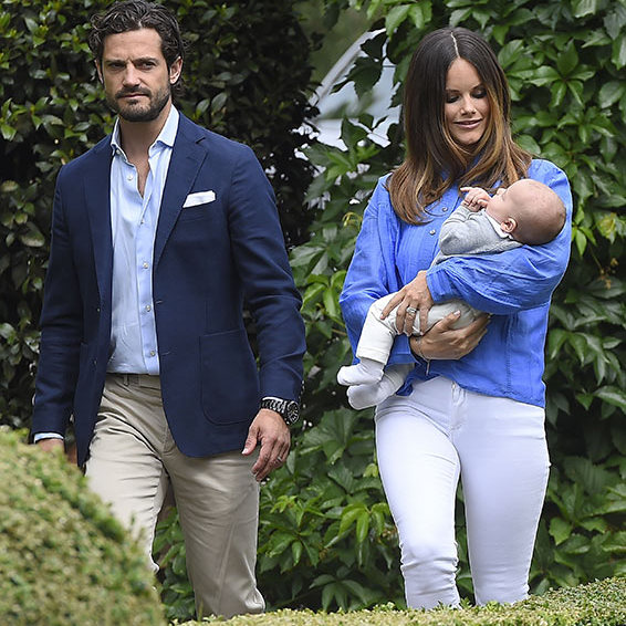 Princess Sofia looked simple yet trendy in a pair of white jeans with a bright blue blouse during the Swedish Royal Family portrait.