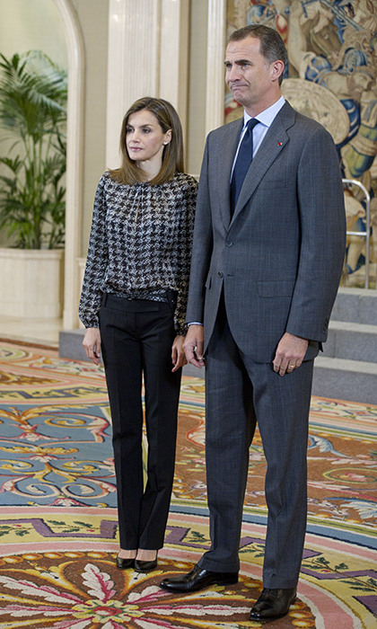 Queen Letizia of Spain looked smart and demure in plain tapered black trousers and an embellished silver and black blouse as she attended a Scholarship Europe event at the University Francisco de Vitoria in Madrid with her husband, King Felipe VI.