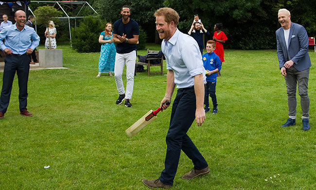 Prince Harry joined in with a game of cricket.