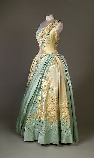 The pale blue and gold evening dress by Sir Norman Hartnell, worn by the Queen on a state visit to The Netherlands in 1958.
