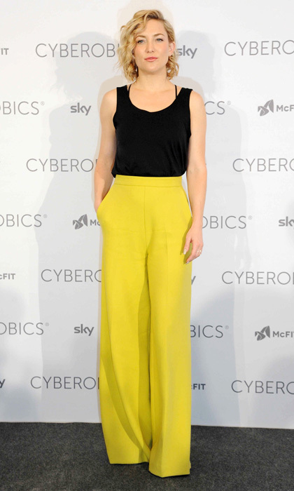 Kate Hudson paired wide-legged, lemon-coloured pants