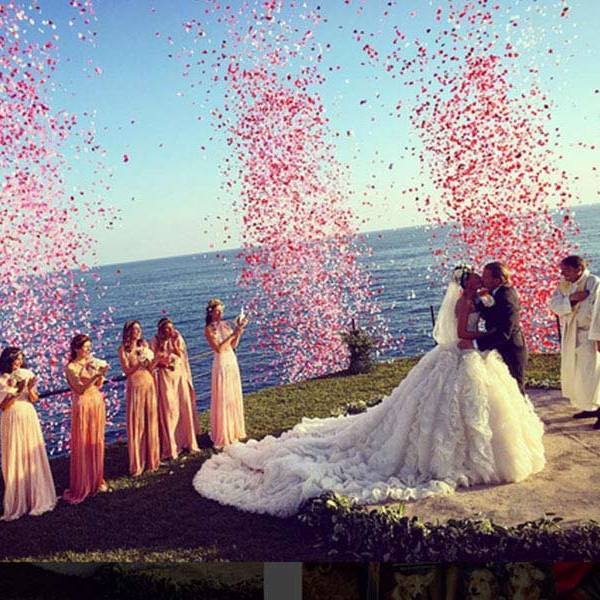 "On saying their vows, heart-shaped confetti was released into the air, and wedding guest New York Times bestselling author Derek Blasberg posted a photo of the moment on Instagram, writing: ""LOVE IS IN THE AIR!#gioandoscar""