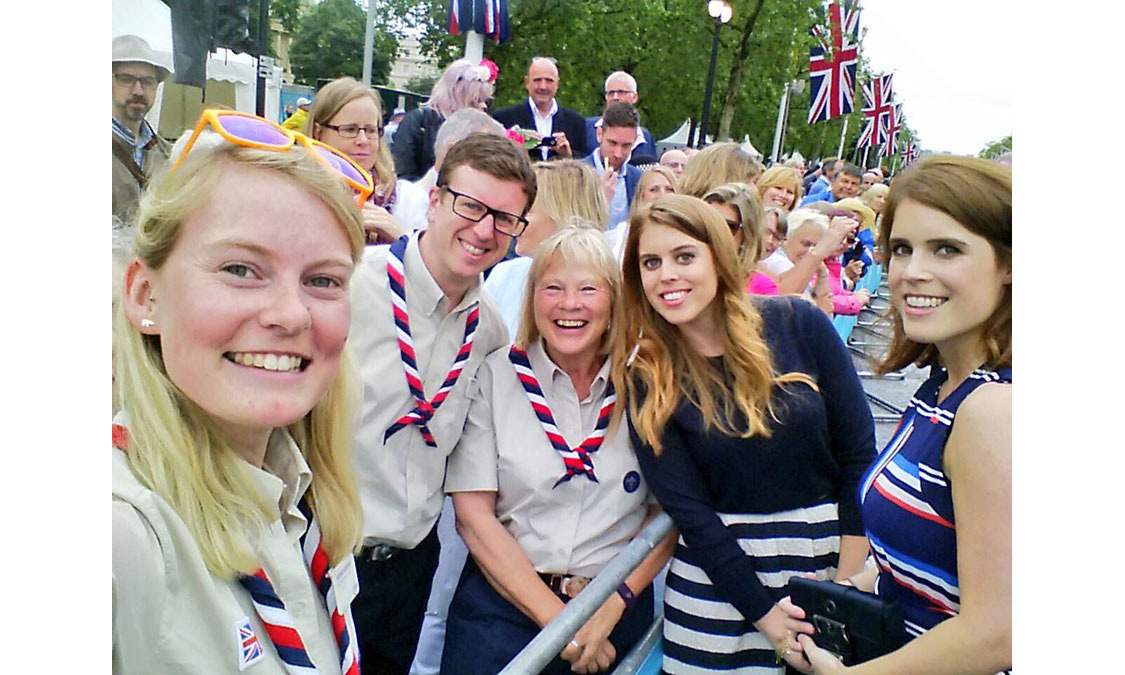 <p>At the Patron's Lunch in 2016, Princesses Beatrice and Eugenie mingled with guests and laughed as a fan pulled out her phone for a selfie.