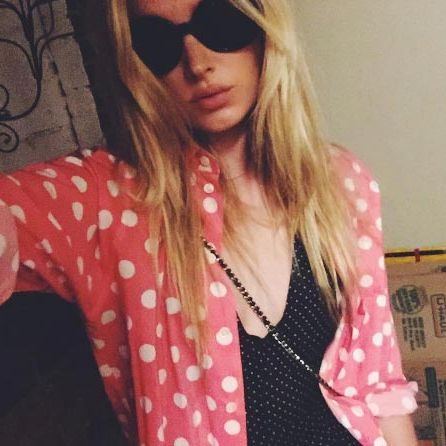 Who says you can't mix prints? Elsa doubles up on polka dots for a cool laidback look.