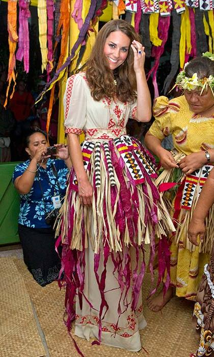 The Duchess strayed from her traditional tailored style with a boho-inspired Alice Temperely dress. She let her hair down in Tuvalu, dancing in a straw skirt and flower crown.