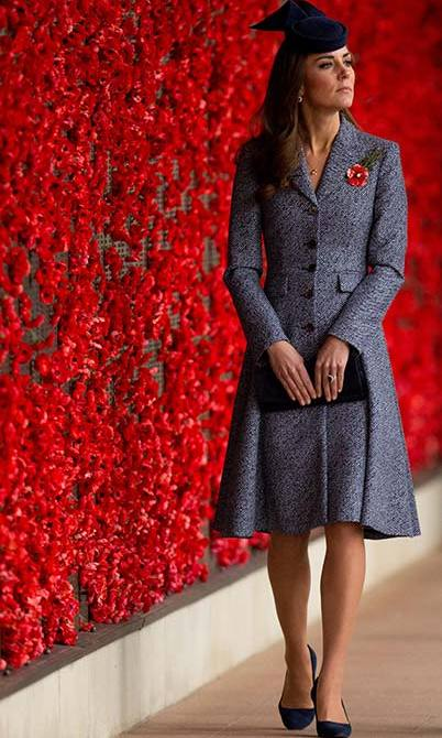 The Duchess of Cambridge wore a navy tweed coat dress by Michael Kors for the Anzac Day memorial service in Australia.