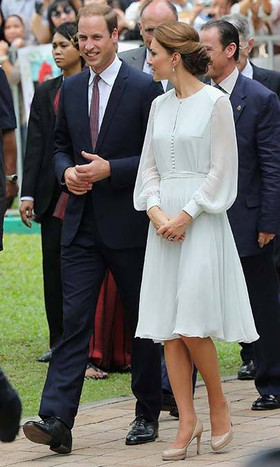 A pale mint Beulah Sabitri dress was chosen for a trip to a mosque in Singapore, and the Duchess covered up with a matching headscarf before entering. She teamed the dress with an LK Bennett clutch and heels.